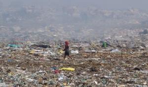 Boy walking on dumpsite