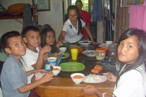 Sponsored children come to pastor's house for lunch during school. They do so much better after good nutrition.