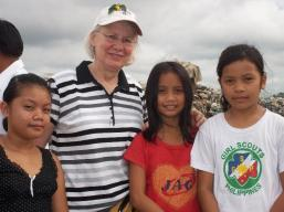 Kathy with sponsored children